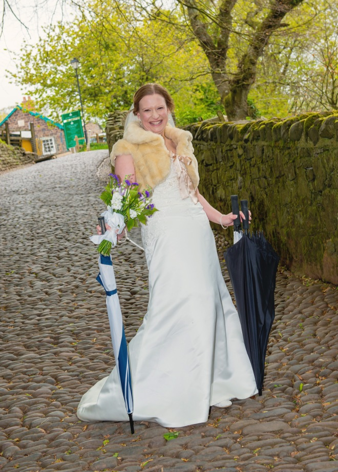 The bride looking very stylish with the brollies!